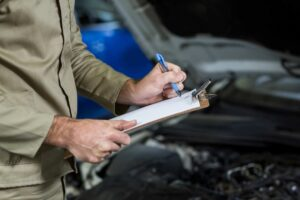 mid-section-mechanic-preparing-check-list