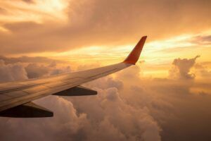 aircraft-wing-clouds-sunset