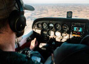 pilot-flying-aircraft-daytime
